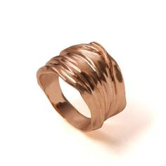 A unisex handmade 18k gold ring.  This ring is made in a special technique giving it the shape and feel of textile in gold.  Wedding rings are