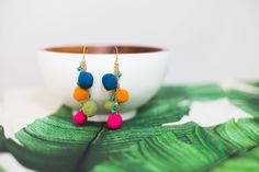 Fun is an understatement with these multi-colored, lightweight pom pom bohemian earrings. Slip these on when you just can't be held back.