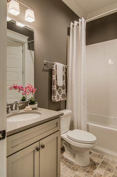 Contemporary Full Bathroom with Flat panel cabinets, limestone tile floors, Slate, Pental Quartz - Alpine BQ300, High ceiling