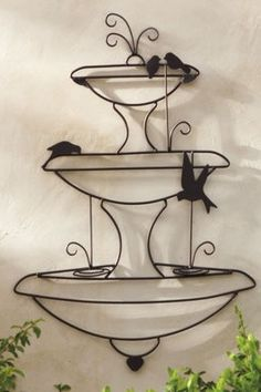 """Birds in a Fountain"" Wall Art provides all the character of the iconic garden embellishment that fits on a wall."