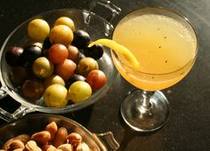 Create a Southern Fall Muscadine cocktail with fresh muscadine grapes, thyme, lemon juice, Applejack and white vermouth