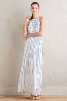 Relaxed Boho: Engagement party at a local park or beach? Wear a relaxed summer dress like this long, striped option from Anthropologie. It won't be a near wardrobe malfunction if a breeze catches it and you can wear it throughout the season.