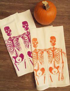 Add a festive touch to the kitchen with these skeleton tea towels.
