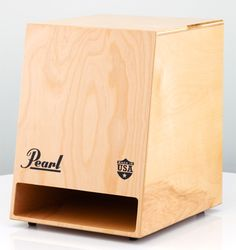 Pearl Cajons Sonic Boom Cajon  Pearl is very excited to introduce the new Sonic Boom Cajon! This Made-in-America beauty has a tonal impact like no other cajon on the market. The all Birch body and front plate provide wondrous resonance that speaks clearly through the Sonic Boom Cajon's frontward facing bass port. The bass port is enhanced by a built-in scoop, directing sound and air pressure through the port, emitting a gloriously rich tone.
