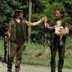 """Andrew Lincoln, Norman Reedus, and baby """"Judith,"""" Behind the scenes? Or in middle of filming? I don't remember this. But it's freakin' cute!!"""