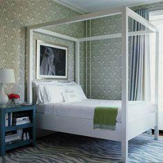 Loving the white bed frame against the fabulous wallpaper!