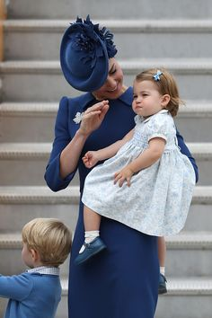 All eyes were on Princess Charlotte, 16 months, making only her third public appearance as she clung to her mother, Catherine, Duchess of Cambridge