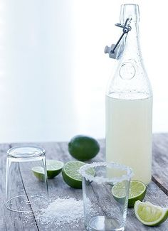 margaritas.  what a good idea to have them made ahead of time and stored in these bottles!
