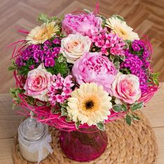 This stunning display of feminine summer colour features eye-catching pink Peonies, cream Germini and two-tone pink and cream Roses. Cerise Sweet William and pink Bouvardia provide the perfect finish to this gorgeous posy which is delivered in a lovely rattan holder, providing an instant display!