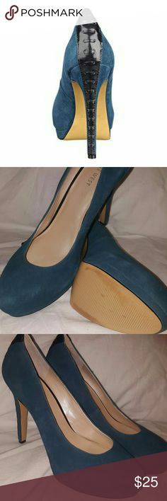 """Hearbeat by Nine West in teal Take your style to new heights in the Hearbeat by Nine West. This suede platform pump will compliment your power suit with ease. Suede upper with faux leather trim Corset style lacing detail at heel cup & heel Round toe 1?"""" platform, 4?"""" heel Synthetic sole Imported View more Nine West Nine West Shoes Heels"""