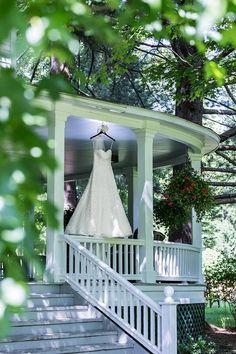 The wraparound porch on the wedding venue -  the perfect spot to hang the dress!