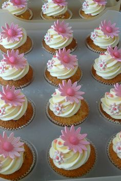cute cupcakes for baby shower or wedding shower & the flower decorations could be changed to the color or flower that the bride will be using in her wedding: