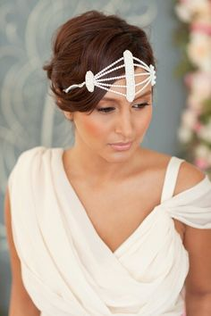 This dramatic headband From Posh Veils inspires us to think of celebrity weddings. With spectacular fresh water pearls this headband features hand beaded fresh water pearls secured with self-tie double faced satin ribbon.