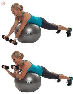 Chris Freytag demonstrating Stability Ball Preacher Curl in a blue tank top on a silver stability ball