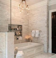 Subway tiles/Carrera, built in niche, love the light fixture, by Shannon Connor / Maison, LLC.