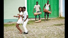 A young couple dances salsa on the streets of Trinidad, Cuba.