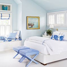 Blue and Periwinkle Beach House Bedroom | The walls are pale aqua (painted Benjamin Moore's Sweet Bluette), while the fabrics, from the custom, upholstered benches to the bedding to the trim on the window shades, feature soft periwinkle.