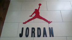 Air Jordan Jumpman logo made from MDF using a CNC router.