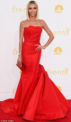 Giuliana Rancic arrived at the 2014 Emmys matching the red carpet in a Gustavo Cadile dress with Louboutin heels http://dailym.ai/1lufdYb