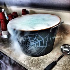 """Witches Brew"" Halloween Adult Party Punch with dry ice... 2 gallons Hawaiian punch, 3 cans pineapple juice, 1 bottle everclear, 1 bottle vodka, 1 bottle Malibu rum (and 8 lb block of dry ice) Be careful! You can't taste the alcohol!! ;)"