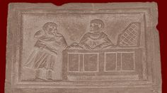 banking scene; Roman, third century CE The banker is shown with a client; the plaque was probably a shop sign. Rome, Vatican Museum, Chiaramonti Corridor. Credits: Barbara McManus, 2007