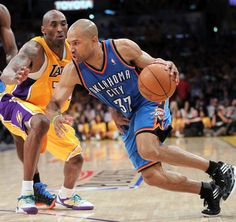 MAY 18: Derek Fisher #37 of the Oklahoma City Thunder moves the ball against Kobe Bryant #24 of the Los Angeles Lakers in Game Three of the Western Conference Semifinals during the 2012 NBA Playoffs on May 18, 2012 at the The Staples Center in Los Angeles, California. (Photo by Layne Murdoch/NBAE via Getty Images)