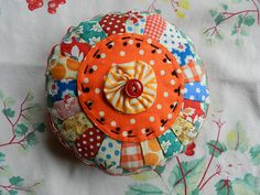 Dresden Plate pin cushion tutorial thanks to the ongoing awesomeness of Mary of Molly Flanders.