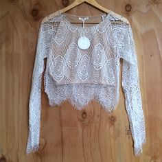 White Lace Crop Top Antigua Lace Top Coachella Brand new / lace crop top with nude lining underneath. Lace sheer sleeves and a crew neck line. Last one in stock - then we're sold out completely. Not for love and lemon brand / breathofyouth.com Brandy Melville Tops Crop Tops