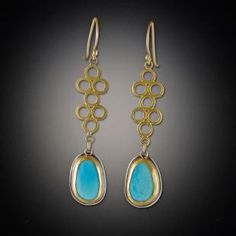 Gold Open Filigree Earrings with Turquoise | Ananda Khalsa Jewelry. Wear a little bit of summer sky each day with this bright turquoise earrings. Each rose cut stone hangs from a 22k gold open filigree charm. 22k bezels, silver backing and 18k earwires.