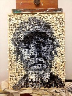 Photo on Joel Phillips: Cigarette Painting Study.  This piece of art was made ENTIRELY out of old cigarette butts.