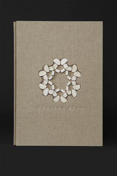 Oversized brand book for jewelry designer Monique Péan. Inlaid with Mammoth bone pieces.