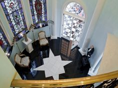 the inside of the turret room of a Victorian style home