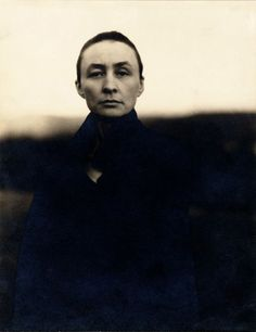 She has invented a language, and has conveyed directly and chastely in paint experiences for which language conveys only obscenities.    Lewis Mumford on Georgia O'Keeffe, 1931 (photo by Alfred Stieglitz)
