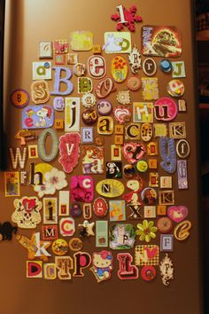 Take letters, from scrapbooking stickers, to magazine cut outs, and turn them into magnets.
