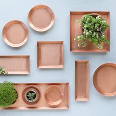 The bright copper of this streamlined, hand-crafted tray makes an eye-catching base for cloches or planters.