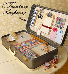 Travelling craft supplies in a vintage suitcase.