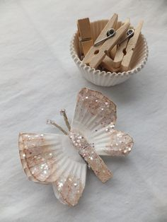 DIY butterfly decorations using cupcake wrappers and miniature clothespins. Elderly Crafts, Elderly Activities, Crafts For Seniors, Crafts For Kids, Arts And Crafts, Senior Citizen Activities, Senior Crafts, Dementia Activities, Craft Activities