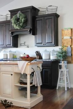 Farmhouse kitchen - love the dark stain cabinets with the lighter island eclecticallyvintage.com