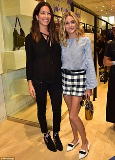 VIP access: Before the show began, she posed with the designer herself (left) in her SoHo shop