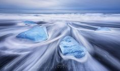 Wet, Wild and Blue - www.patrickmarsonong.com  Blue ice and swirling waves! No where else but Iceland.   This is one of those beer weather of my trips. I usually stay in the lodge/camp and share awesome stories over drinks with fellow photogs when I know that there's zero potential for good light. Buuuuuuut, I'm glad that I went out this time. Its so coooool to see the ice beach at such a different mood. These glistening blue-colored icicles, soooo lovely!!   Winter is almost approaching…