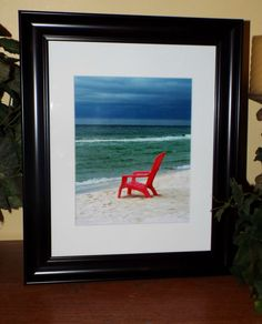 a cloudy day on panama city beach beach chair wall art framed photography cloudy beach coastal decor beach frame coastal photography