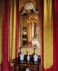 127 A close up of a mirror and curtains in the Queen Anne Room at Dyrham Park, Gloucestershire