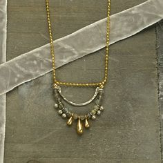 gold chain, silver dangles, bronze charms, scallop necklace, scallop jewelry, jewelry trend, necklace design, finished jewelry