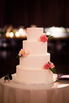 Classic buttercream wedding cake design with handmade sugar floral to match the fresh floral. Photo by @studiothisis