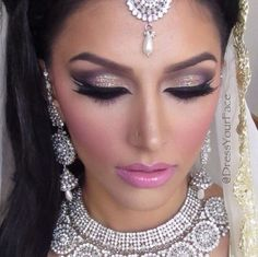 Modern bride #1 Lots of glitter around the eyes with winged eyeliner, this look is very modern especially for maybe an Arabic bride, the cheeks are flush with pink blusher in the same shade as the bride has for her pink lip.
