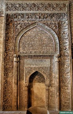 Exquisite stucco mihrab awash with dense Quranic inscriptions and floral designs