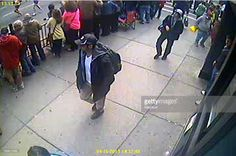 In this image released by the Federal Bureau of Investigation (FBI) on April 18, 2013, two suspects in the Boston Marathon bombing walk near the marathon finish line on April 15, 2013 in Boston, Massachusetts. The twin bombings at the 116-year-old Boston race resulted in the deaths of three people with more than 170 others injured.