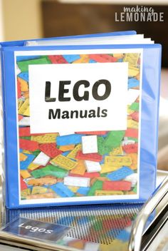 FINALLY a great way to organize LEGO manuals! Love this organization tip. FINALLY a great way to organize LEGO manuals! Love this organization tip. Playroom Organization, Organization Hacks, Lego Organizing, Board Game Organization, Playroom Ideas, Legos, Lego Lego, Lego Batman, Construction Lego