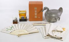 Lot 203: Decorative Asian Object Assortment; Including a Chinese pewter duck form covered serving dish with stone insets, a 2006 McDonald's China Operations Convention amber glass souvenir by Shenzhen Best Art Industries amber glass, a painted egg in a display box, Chinese sticks in box and a fan