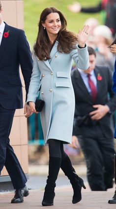Kate's gorgeous double-breasted Matthew Williamson coat, which she threw over a foundation of black separates, made her appear light and polished for her visit to Pembroke Refinery.